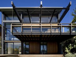 Use of steel, glass and recycled timbers creates a modern home that feels calm and confident