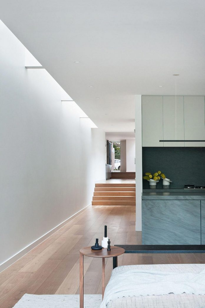 behind-unassuming-facade-courtyard-house-opens-reveal-pared-back-design-response-mixed-luxurious-materials-practical-detailing-12