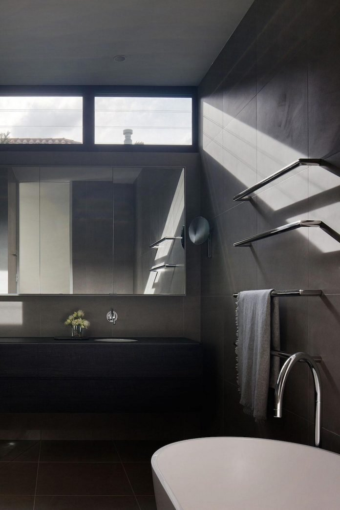 behind-unassuming-facade-courtyard-house-opens-reveal-pared-back-design-response-mixed-luxurious-materials-practical-detailing-24