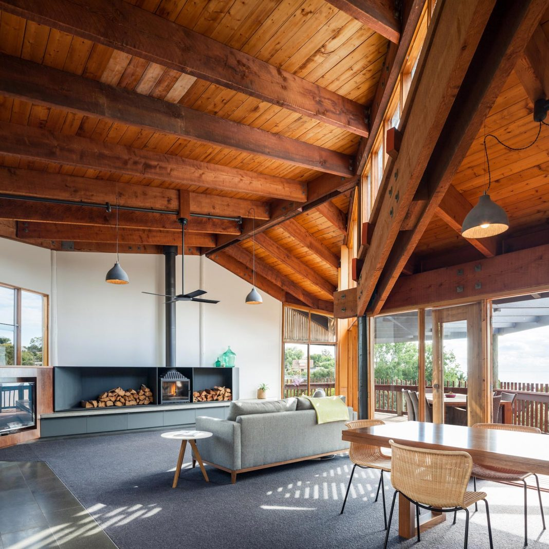 Contemporary Chamfer House revisits a post and beam dwelling designed in 1977 by Kevin Borland