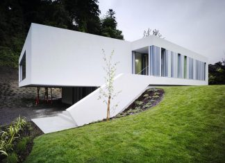 Dwelling at Maytree: a simple bold sculptural form which sits at the foot of a steep escarpment in the Wicklow hills