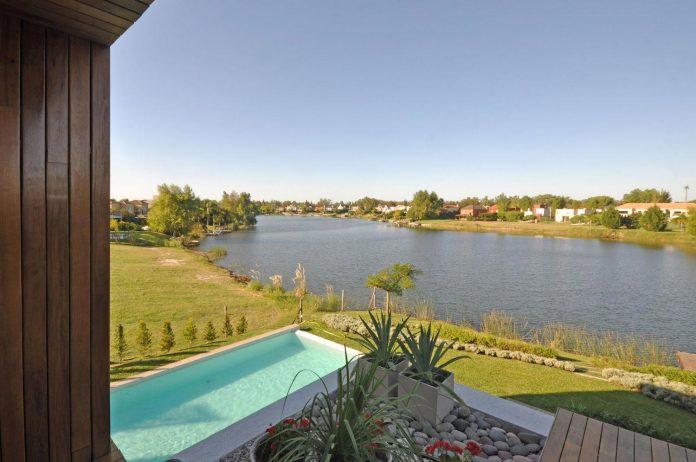 frame-residence-situated-rectangular-lot-backyard-towards-inner-lake-gated-neighborhood-02