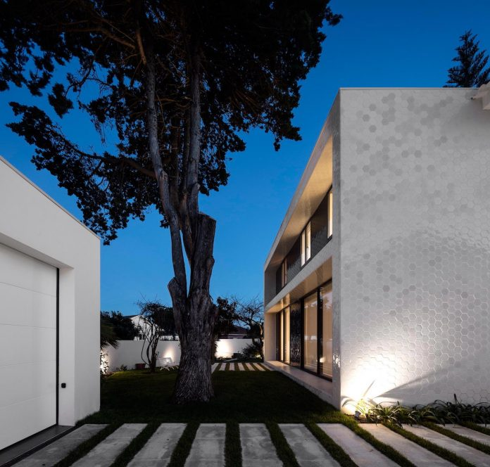 hexagonal-tile-pattern-extension-new-volume-attached-rear-facade-old-house-21