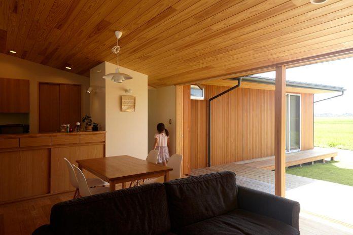 house-kimitsu-located-countryside-city-okayama-fields-rice-paddies-spread-01