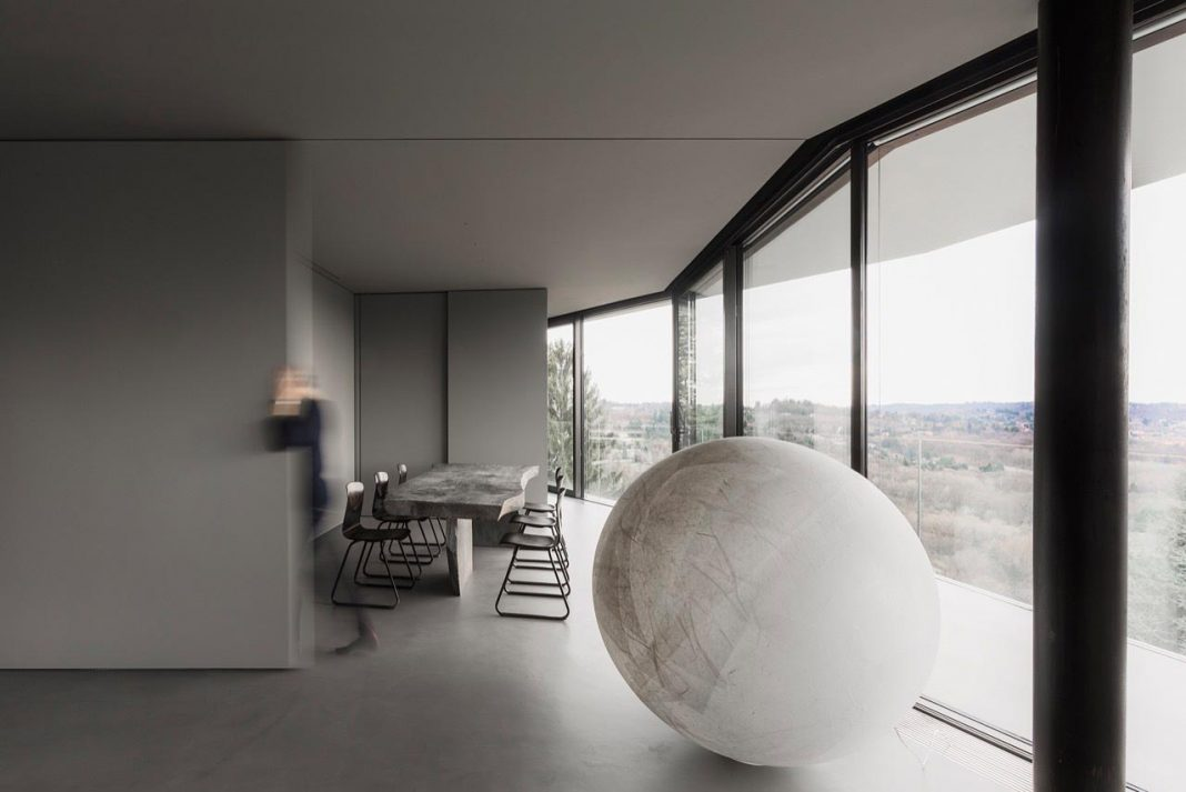 Minimalist home located high on a hillside in a residential settlement in the Province of Varese