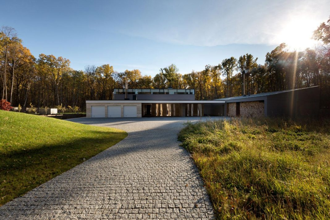 Modern House With A Peristyle Located In An Oak Tree Forest That Is  Homogenous In