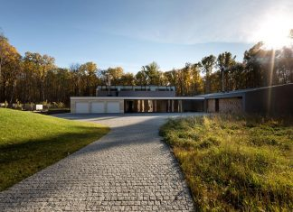 Modern House With A Peristyle located in an oak-tree forest that is homogenous in its structure