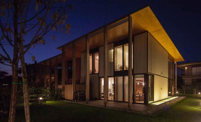 twin-house-consists-two-cubic-volumes-mounted-concrete-basement-designed-studiopietropoli-23