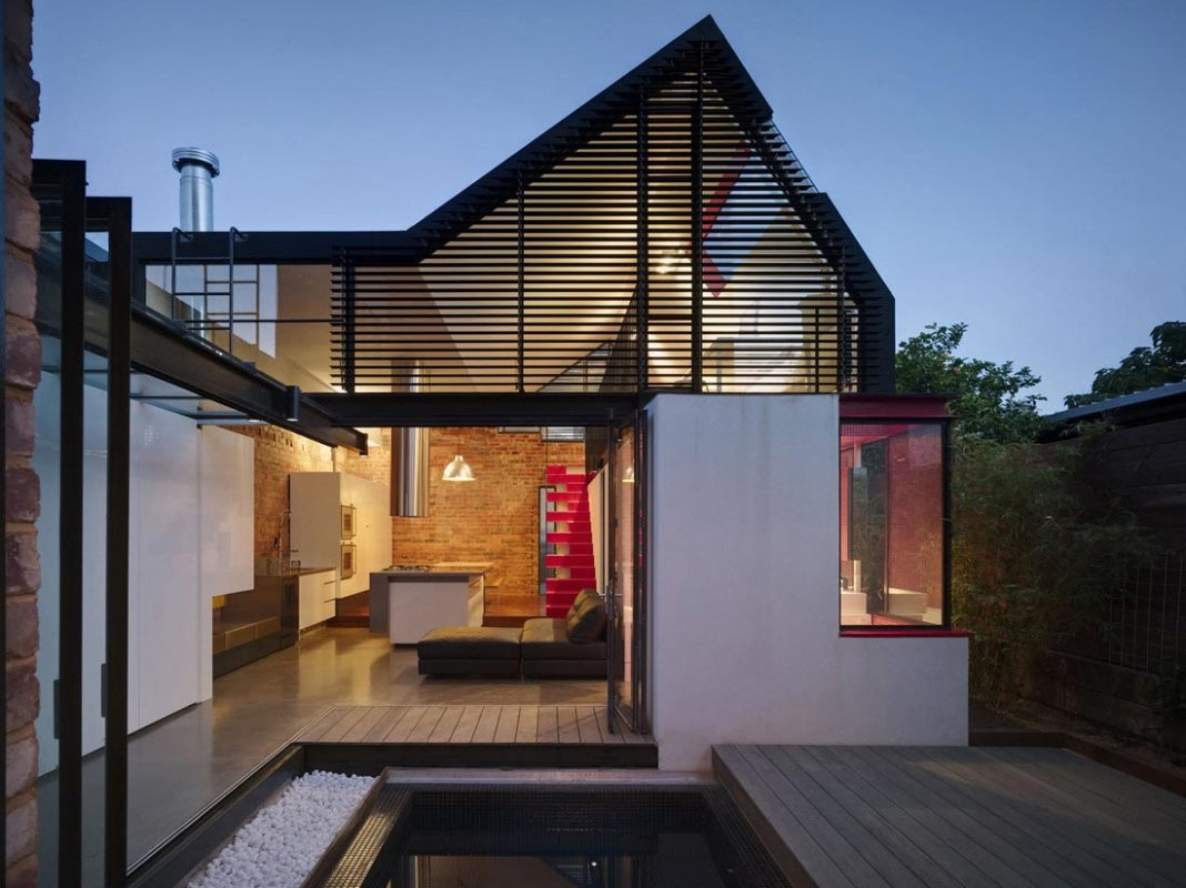 Vader House Victorian Terrace features a modern framed steel skeleton extension