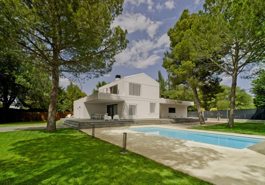 White F A House Situated In A Residential Area On The