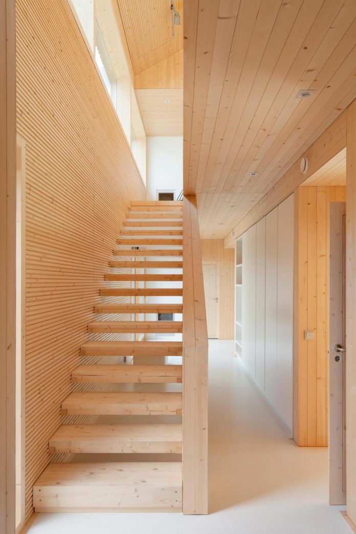 wooden-building-situated-traditional-residential-area-kivistonmaki-built-architects-family-04
