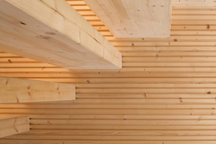 wooden-building-situated-traditional-residential-area-kivistonmaki-built-architects-family-07