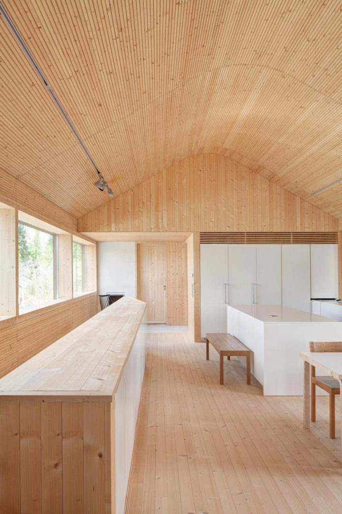 wooden-building-situated-traditional-residential-area-kivistonmaki-built-architects-family-14