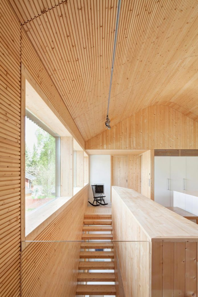 wooden-building-situated-traditional-residential-area-kivistonmaki-built-architects-family-15