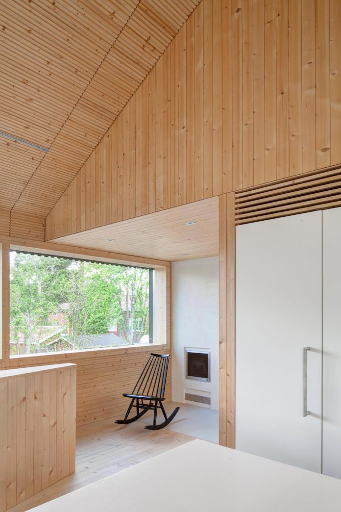 wooden-building-situated-traditional-residential-area-kivistonmaki-built-architects-family-17
