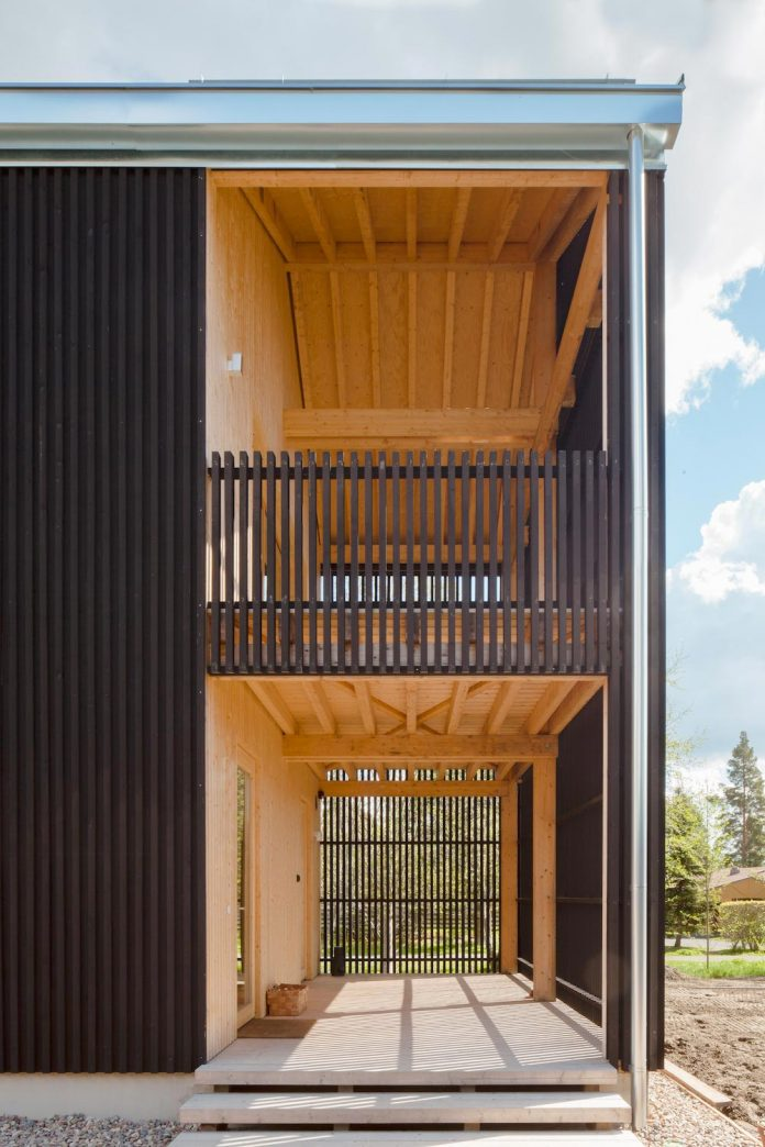 wooden-building-situated-traditional-residential-area-kivistonmaki-built-architects-family-20