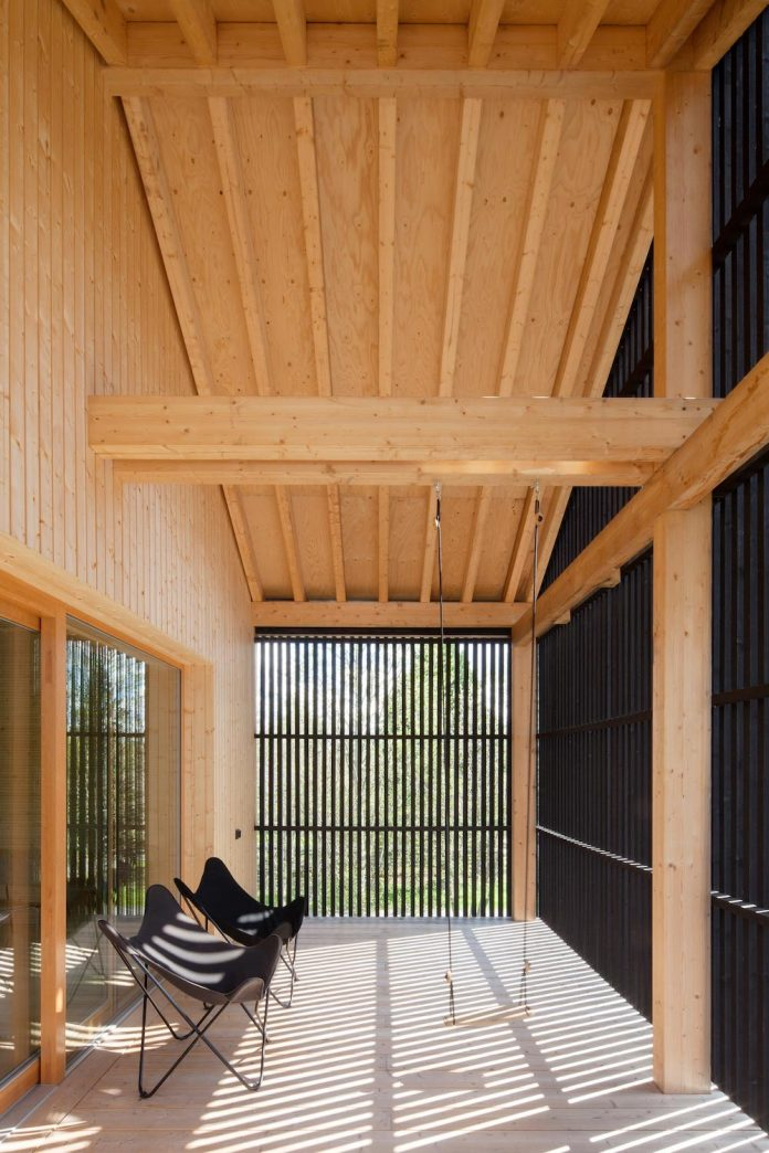 wooden-building-situated-traditional-residential-area-kivistonmaki-built-architects-family-21