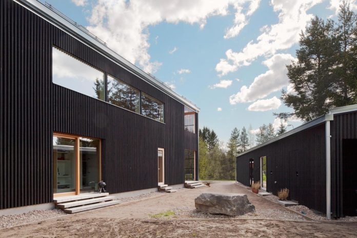 wooden-building-situated-traditional-residential-area-kivistonmaki-built-architects-family-22