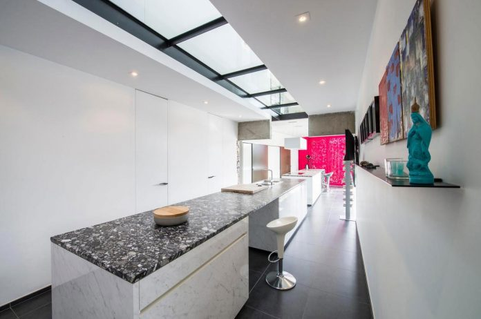 artipool-transformed-former-bakery-bright-airy-home-thanks-double-height-living-space-skylight-kitchen-huge-windows-thin-profiles-15