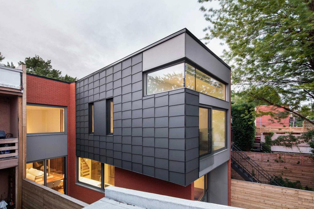 Conversion of a 20th-century duplex into a single-family dwelling, with the intent of creating a bright, open-space house