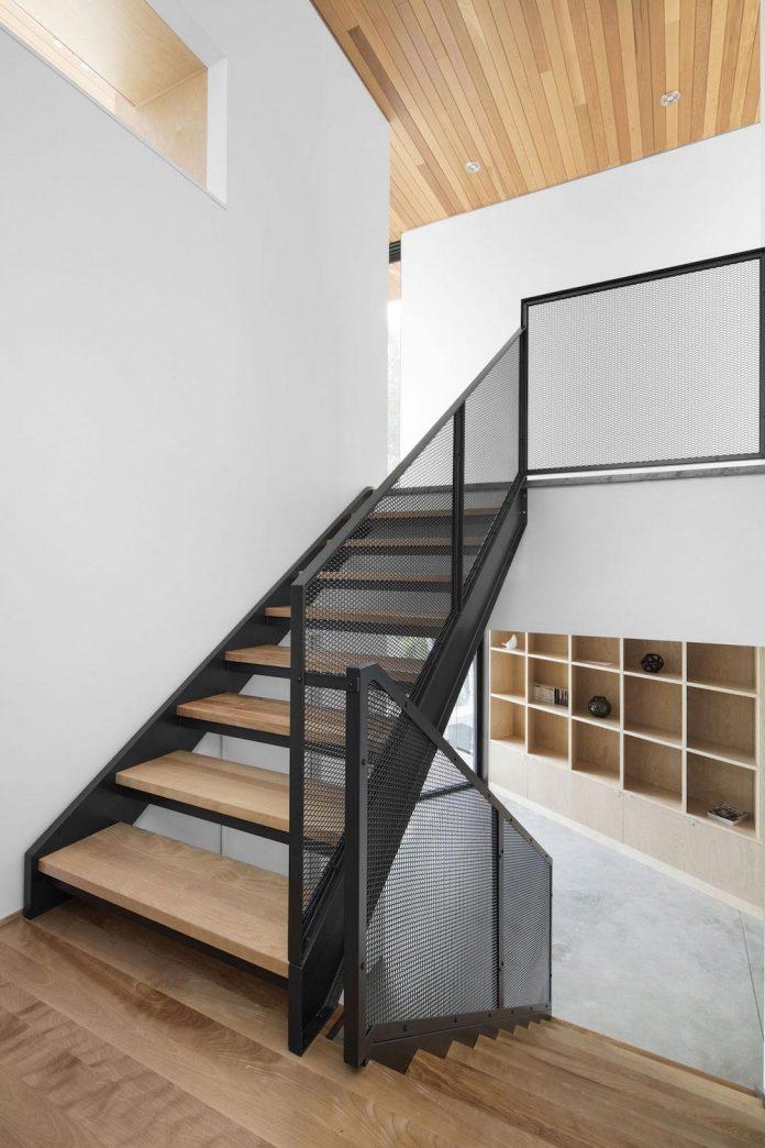 mountain-residence-cap-laigle-v-shape-long-facades-suspended-nature-09