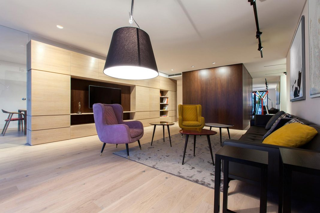 Natural materials and elegant pieces of furniture of a new apartment located in the old town of Bratislava
