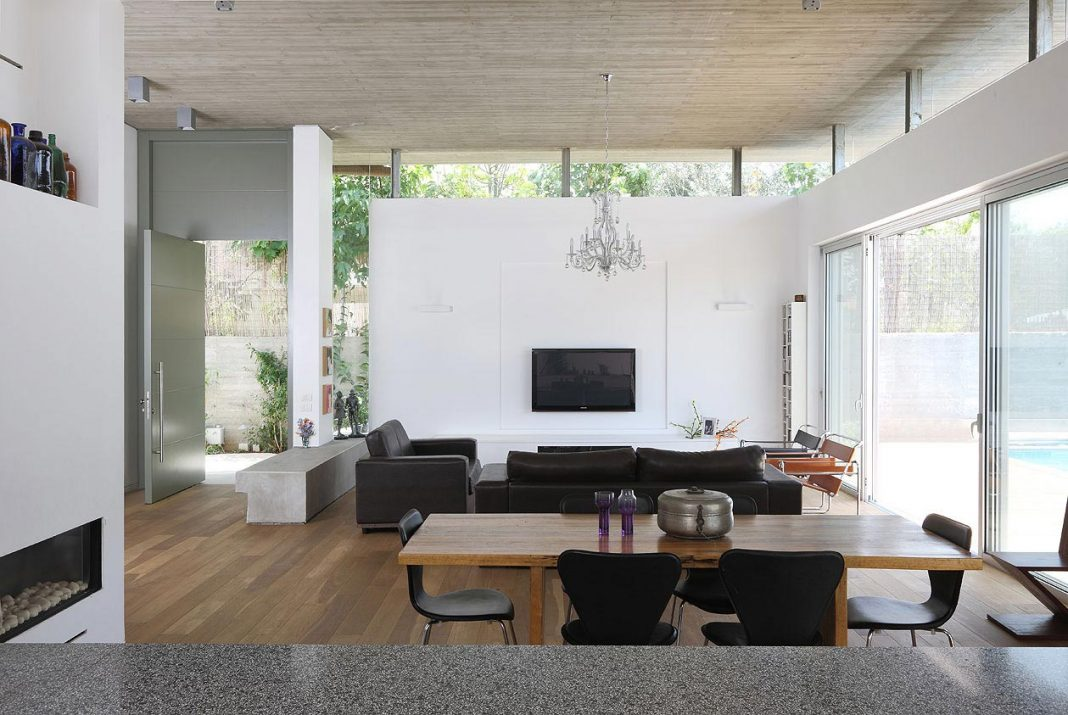 One-and-a-half storey high interior house designed for a family with ...