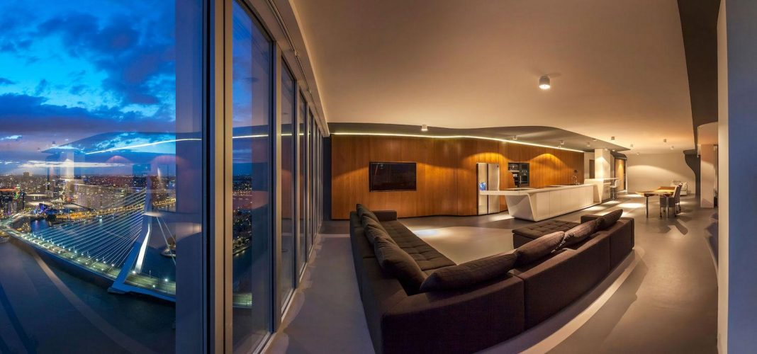 Panoramic view on the Rotterdam cityscape of a 43rd floor huge modern apartment