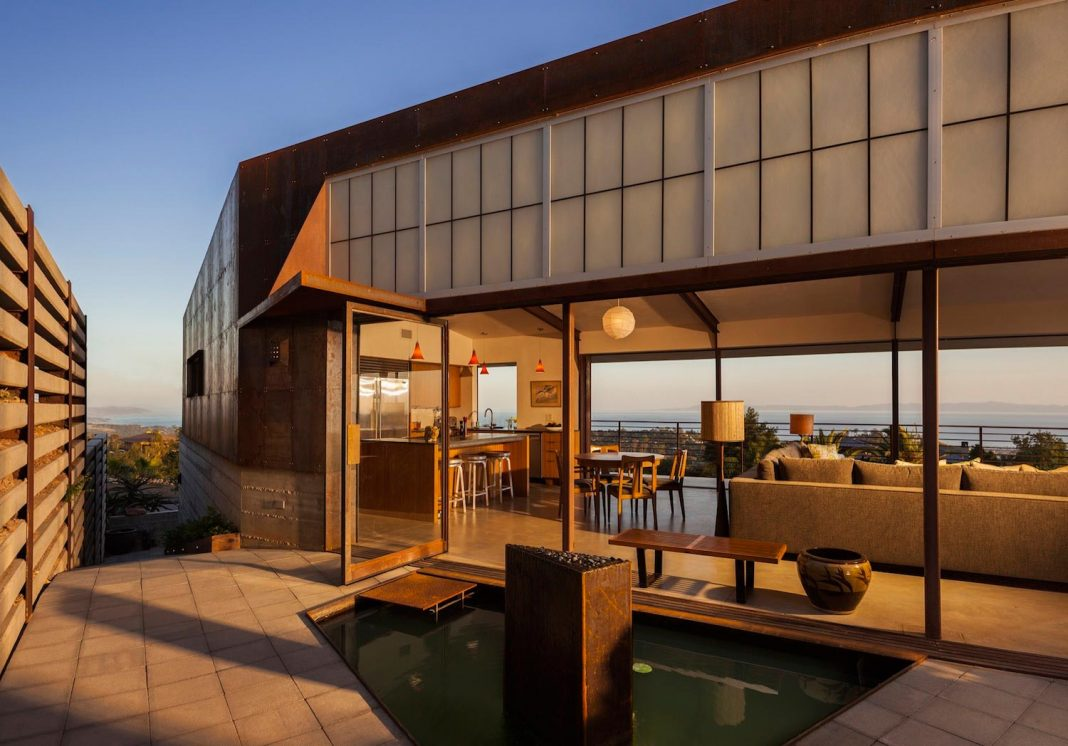 Raw corten steel and concrete exterior dress the Crossing Wall House, sited where the Santa Ynez Mountains meet the Pacific Ocean