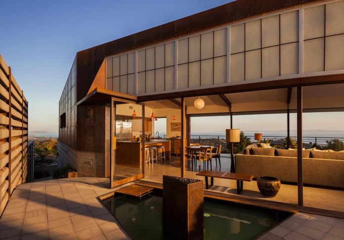 raw-corten-steel-concrete-exterior-dress-crossing-wall-house-sited-santa-ynez-mountains-meet-pacific-ocean-02
