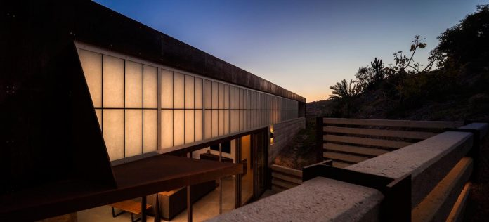 raw-corten-steel-concrete-exterior-dress-crossing-wall-house-sited-santa-ynez-mountains-meet-pacific-ocean-04