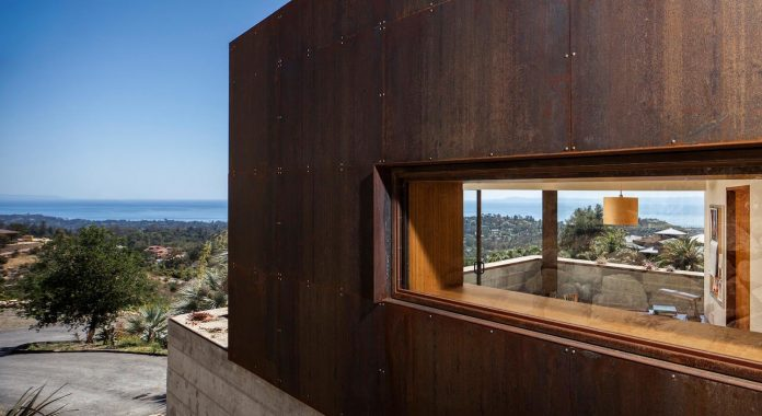 raw-corten-steel-concrete-exterior-dress-crossing-wall-house-sited-santa-ynez-mountains-meet-pacific-ocean-06