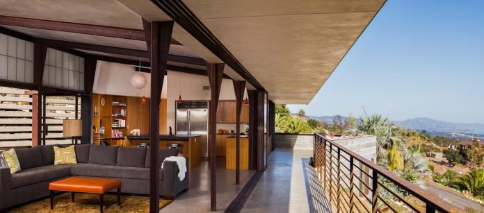 raw-corten-steel-concrete-exterior-dress-crossing-wall-house-sited-santa-ynez-mountains-meet-pacific-ocean-07