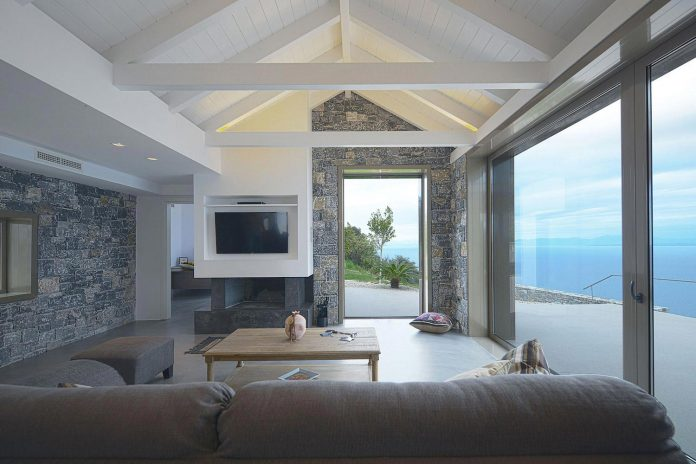 Sea view villa in Pera Melana, Greece with use of various materials and alteration of the design