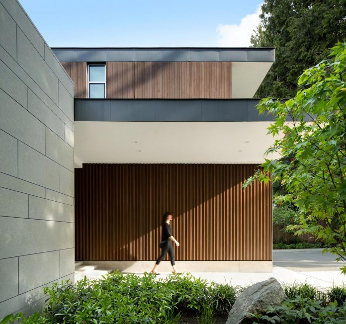 modern-elm-street-residence-is-dominated-by-very-mature-evergreen-trees-and-high-garden-hedges-01