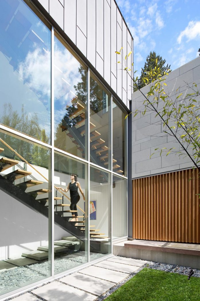 modern-elm-street-residence-is-dominated-by-very-mature-evergreen-trees-and-high-garden-hedges-02