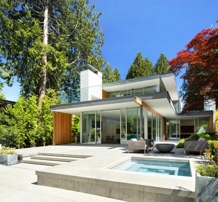 modern-elm-street-residence-is-dominated-by-very-mature-evergreen-trees-and-high-garden-hedges-05