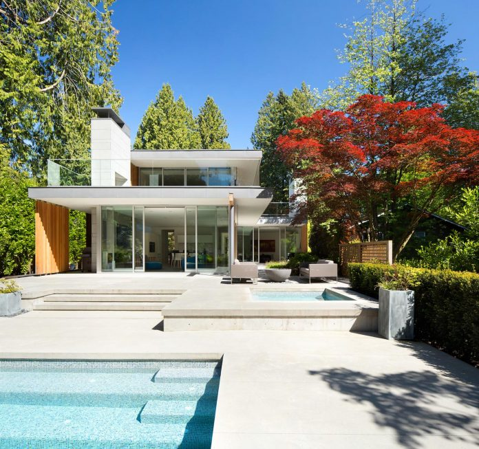 modern-elm-street-residence-is-dominated-by-very-mature-evergreen-trees-and-high-garden-hedges-07