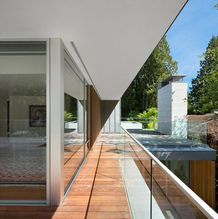 modern-elm-street-residence-is-dominated-by-very-mature-evergreen-trees-and-high-garden-hedges-14