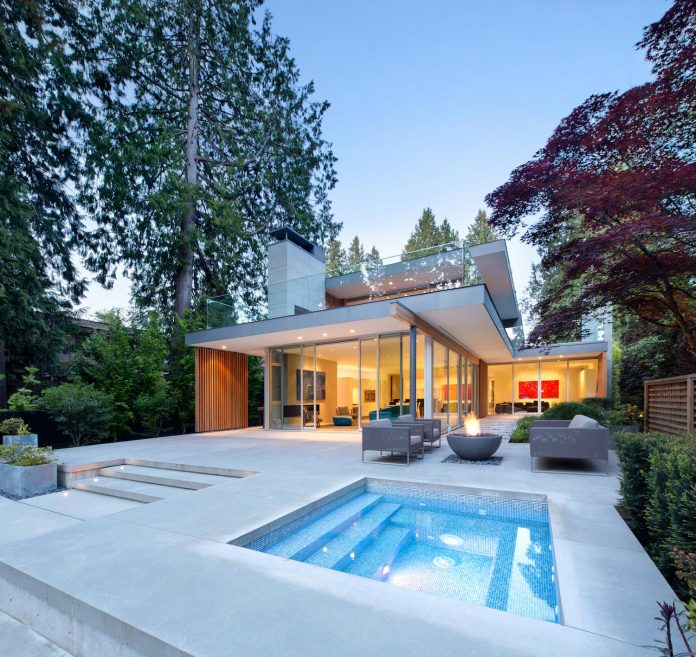 modern-elm-street-residence-is-dominated-by-very-mature-evergreen-trees-and-high-garden-hedges-16