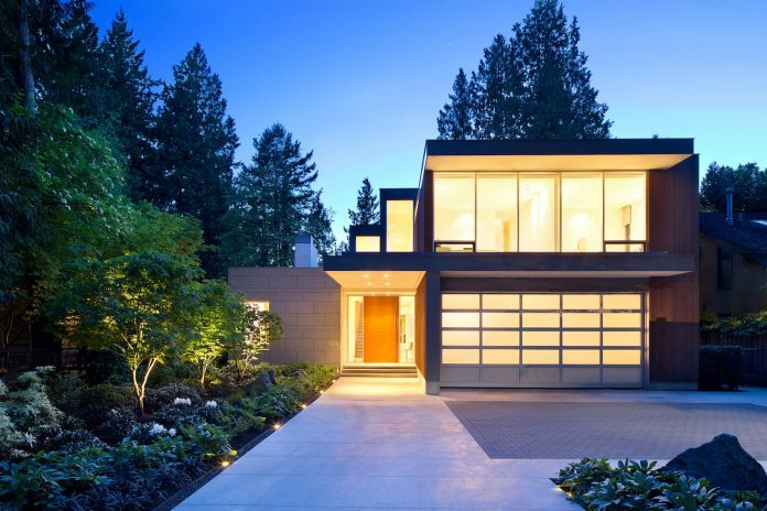 modern-elm-street-residence-is-dominated-by-very-mature-evergreen-trees-and-high-garden-hedges-17