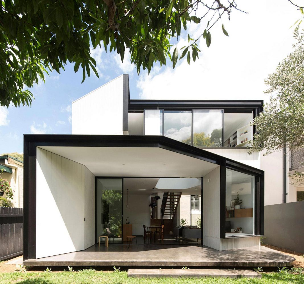 An articulated two-storey volume is sensitively stitched to the rear fabric of a Federation masonry