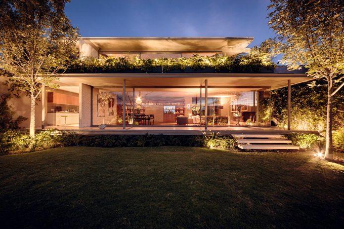 caucaso-house-rises-sidewalk-surrounding-trees-14