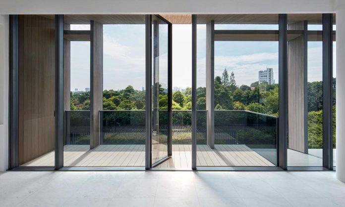 cluny-park-residence-set-lush-tropical-landscape-across-street-singapore-botanic-gardens-08