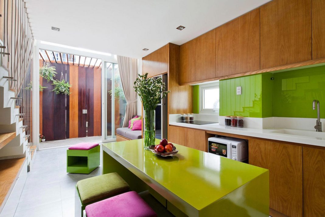 Colorful small town house with an irregular shape situated in central district of Ho Chi Minh City