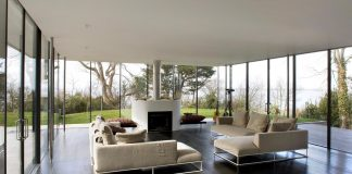 Compact 1960's bungalow gets a renovation and extension with a glass pavilion living room