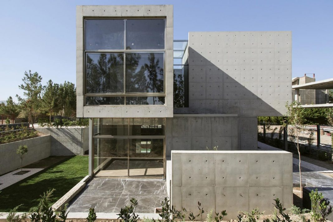 Concrete modern home has sunken courtyard to remain protected and unseen