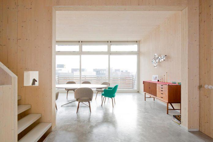 five-storey-wood-carving-home-built-prefab-wood-elements-03