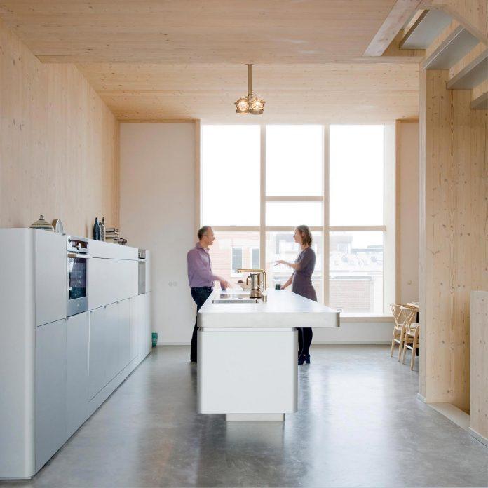 five-storey-wood-carving-home-built-prefab-wood-elements-04