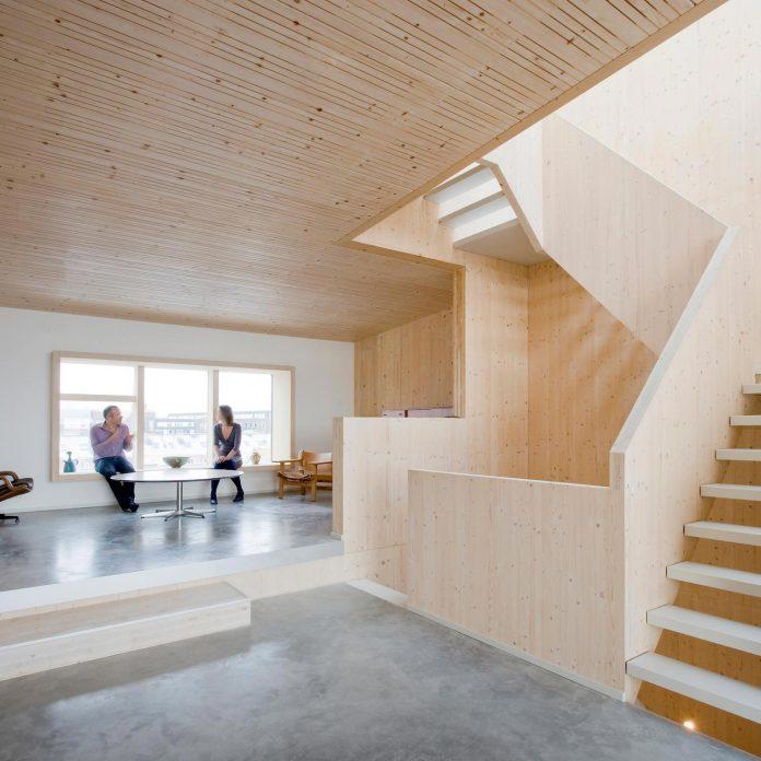 five-storey-wood-carving-home-built-prefab-wood-elements-06